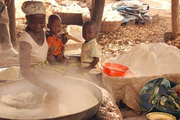 A woman roasting cassava