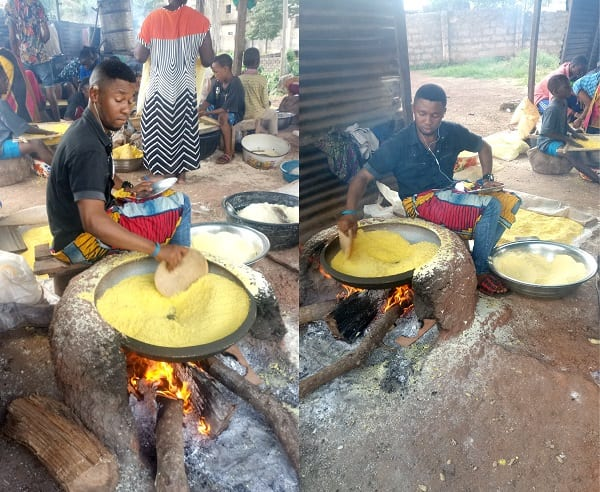 A young man roasting garri